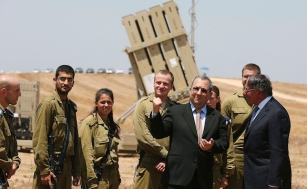 Israeli Defense Minister Barak and U.S. Defense Secretary Panetta greet Israeli soldiers after a joint news conference in Ashkelon